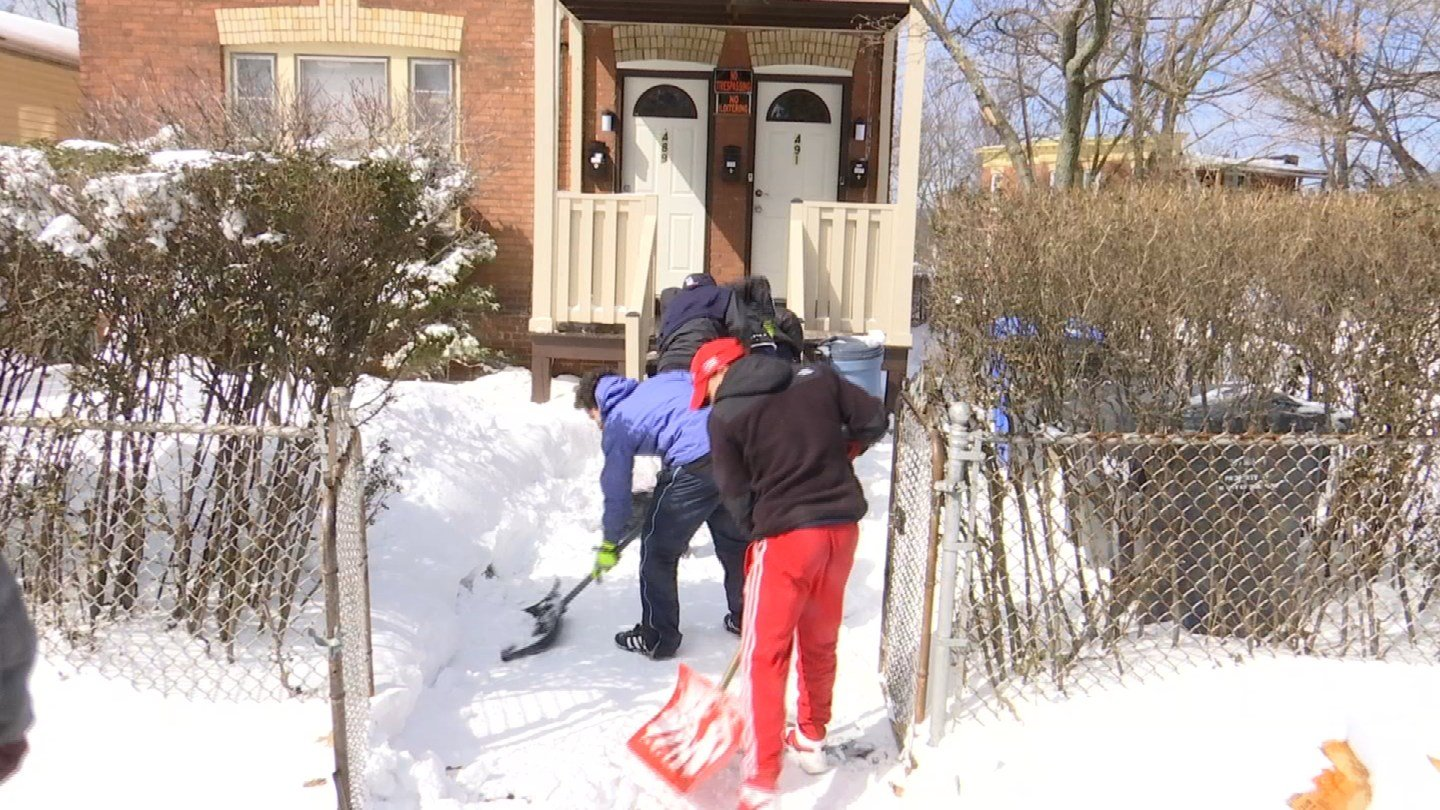 Teens helped clear driveways and sidewalks for Hartford residents on Wednesday (WFSB)