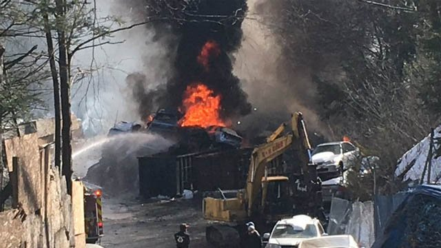 Crews worked to put out a fire at a salvage yard in Waterbury (WFSB)