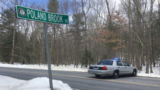 A body was found in a bag along a reservoir in Harwinton, according to state police. (WFSB photo)