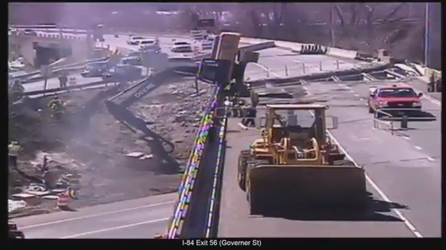 An excavatortipped over on a bridge on Route 2 westbound in East Hartford on Wednesday afternoon. (DOT photo)