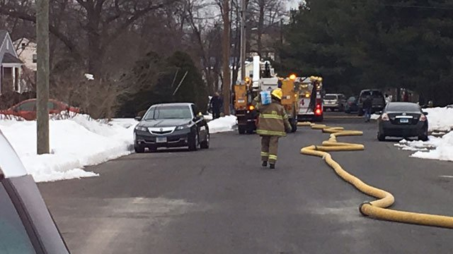 Firefighters are battling a fire at a condo complex in Plainville on Friday. (WFSB)