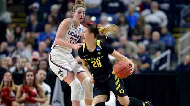 Oregon's Sabrina Ionescu drives against Connecticut's Katie Lou Samuelson during the first half of a regional final game in the NCAA women's college basketball tournament, Monday. (AP Photo/Jessica Hill)