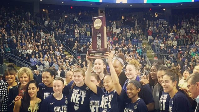 The UConn women's basketball team celebrates its East Regional Championship on Monday night. (@UConnHuskies photo)
