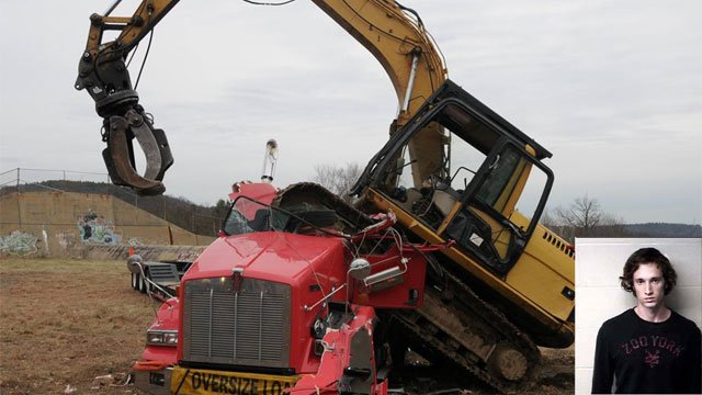 A Massachusetts man crushed a truck with excavator in Winchester. (CT State Police)