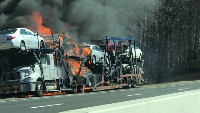 A car carrier fire caused a section of I-95 southbound to be shutdown Sunday. (WFSB)