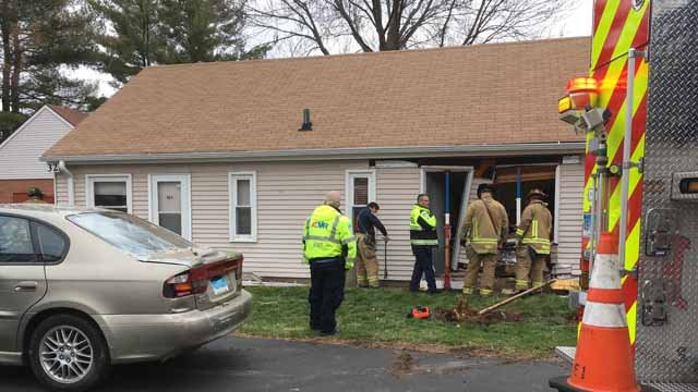 A car crashed into a residential building in West Hartford on Wednesday (WFSB)