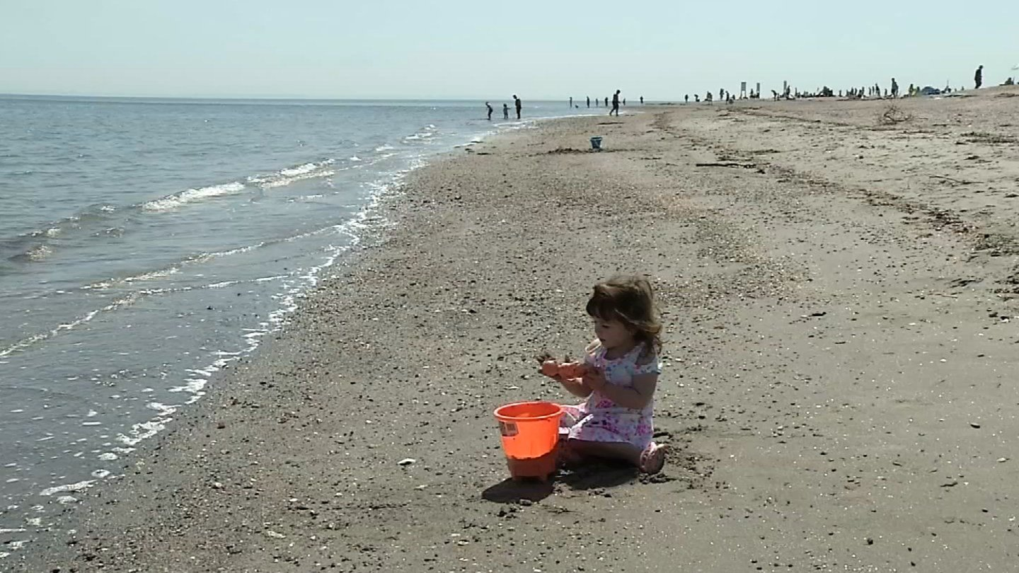 Avianna Hayes from Ansonia enjoys a beach day at Silver Sands State Park in Milford. (WFSB photo)