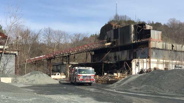 Crews are investigating a fire at a vacant building in Newington (WFSB)