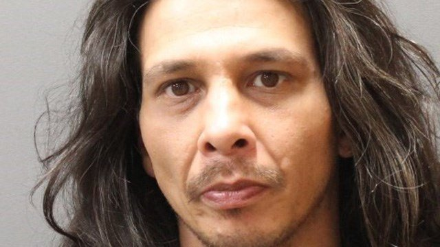 Brent Ramos was wanted on five arrest warrants and found hiding under a pile of laundry in Plainfield. (Plainfield police)