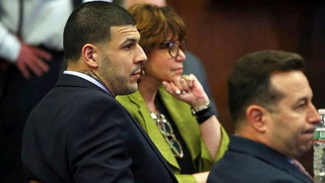 Former New England Patriots tight end Aaron Hernandez, left, sits at the defense table when court is adjourned without a verdict on day five of jury deliberations in his double murder trial at Suffolk Court. (Nancy Lane/The Boston Herald via AP, Pool)
