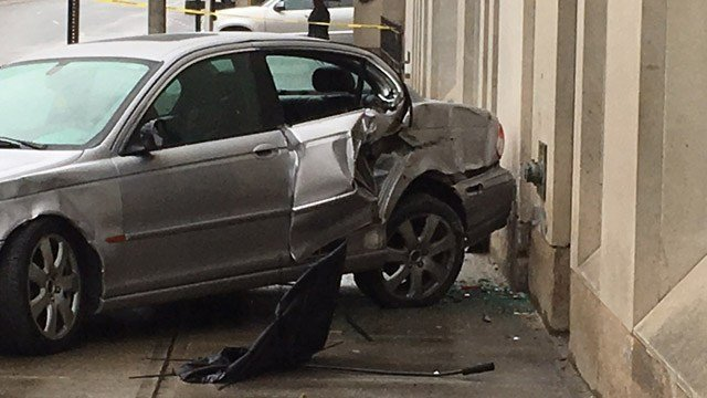This silver Jaguar hit two people waiting for the bus. (WFSB photo)
