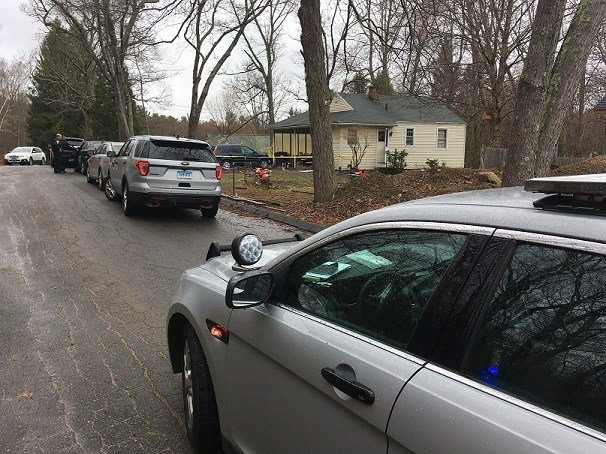 Police tape surrounds the home where a 3-year-old died today.  (WFSB photo)