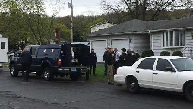 The bomb squad and state environmental officials were called to a home in New Haven. (WFSB)