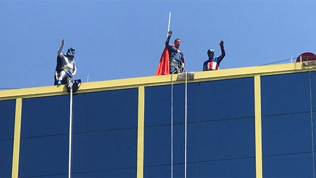 Costumed window washers entertain kids at CCMC on Friday. (WFSB)