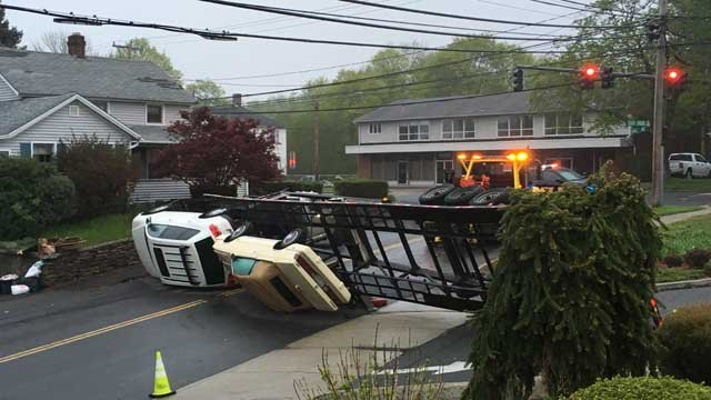 Two vehicles fell from a car carrier early Monday morning in Meriden (WFSB)