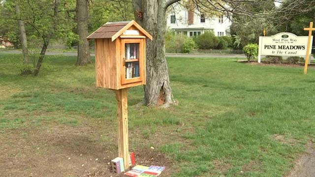 A bench was stolen from a woman's 'little library' in Plainville (WFSB)