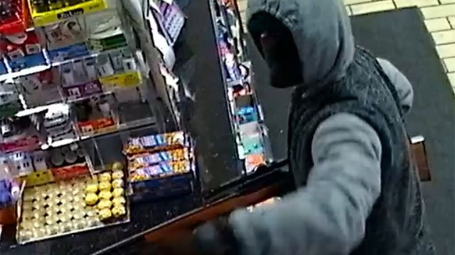 An unidentified man pointed a large rifle with a scope at the clerk. (Stratford Police Department)