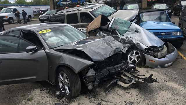 A car crashed into three parked cars outside a dealership on Monday (East Windsor police)