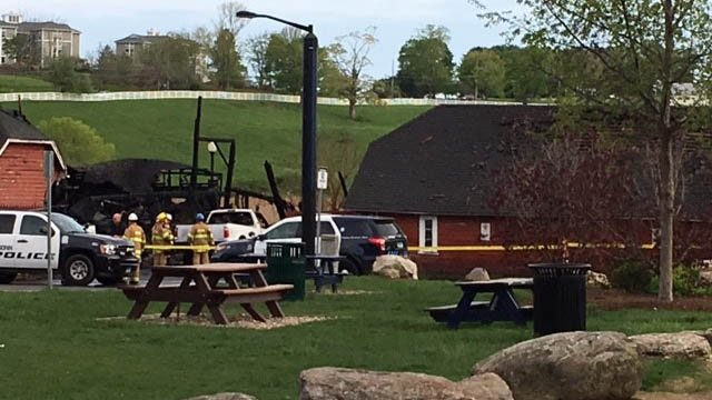 The remains of a barn that stored farm equipment on the University of Connecticut's Storrs campus. The barn was destroyed by a fire. (WFSB photo)