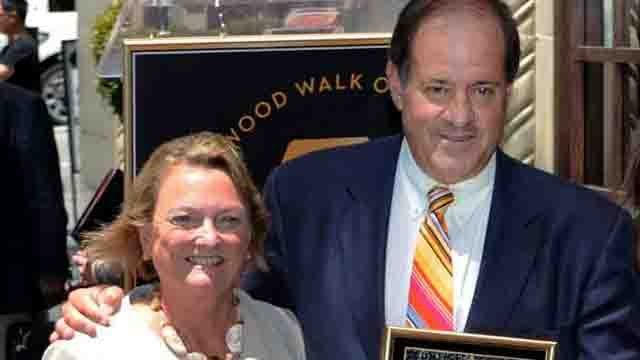 In this May 24, 2010, photo provided by ESPN, sportscaster Chris Berman stands with his wife, Katherine, upon receiving his star on the Hollywood Walk of Fame in Los Angeles. (Scott Clarke/ESPN Images via AP)