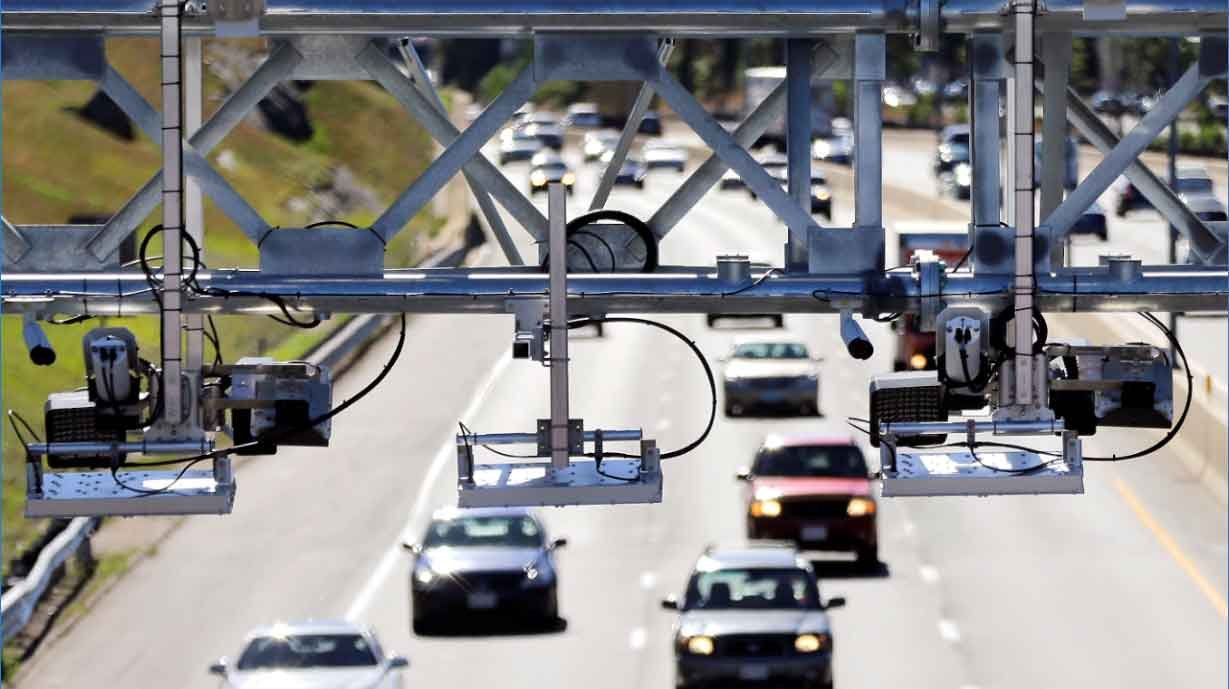Connecticut is looking to implement an all-electronic tolling system similar to this one in Massachusetts. (AP Photo/Elise Amendola)