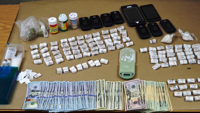 Heroin, crack cocaine, cell phones, marijuana and narcan were seized during 'Operation Smackdown.' (Watertown police photo)