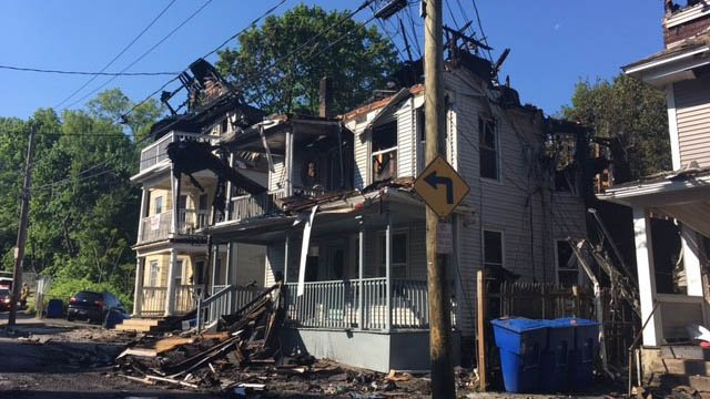 Firefighters and police remained on the scene of a Waterbury fire that broke out on Wednesday night. (WFSB photo)