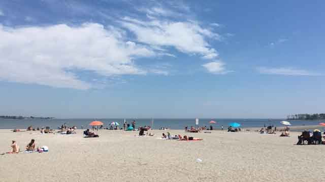 People flocked to Silver Sands Beach on Thursday to beat the heat (WFSB)