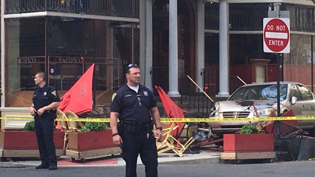 A vehicle crashed into the outdoor seating area of a restaurant in New Haven on Friday afternoon. (WFSB)