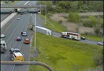 Tractor trailer ends up on its side along the I-84 eastbound exit 28 ramp.  (CT DOT camera)