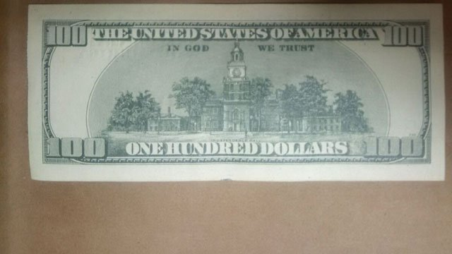 Police seize 13 counterfeit $100 bills. (New London Police Department)