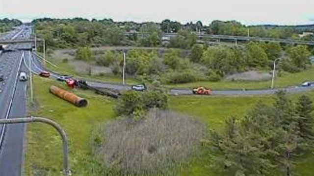 An overturned tractor-trailer was causing traffic delays on the eastbound side of Interstate 84 in Southington on Friday. (CT DOT)