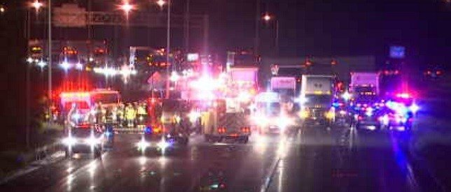 Emergency crews blocking I-91 southbound Friday night in Rocky Hill after a deadly crash.  (WFSB)