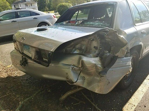 Damage left behind to a State Police cruiser after it was struck along I-395.  (Conn. State Police)