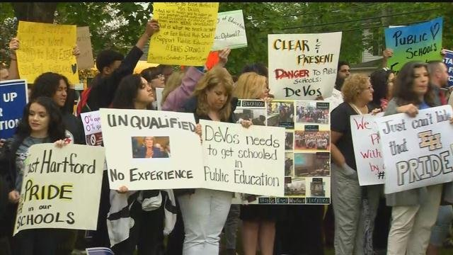 Educators prepare for a rally against remarks made by Education Secretary Betsy Devos. (WFSB)