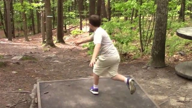 Wyatt Mahoney nails an 'ace' during a disc golf competition in Massachusetts. (Kids Disc Golf Facebook photo)