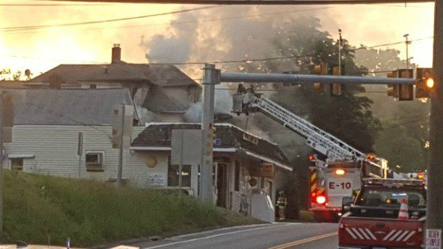 Crews are battling a house fire on Main Street in Terryville on Friday morning (WFSB)