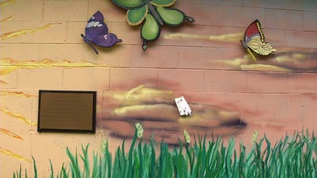 Southington police say a wooden butterfly is missing from a mural along the Rails to Trails (WFSB)