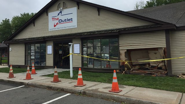 A car crashed into a building in Canton on Tuesday. (WFSB)