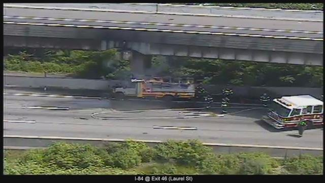 A school bus caught on fire on Interstate 84 eastbound in Hartford. (CT DOT)