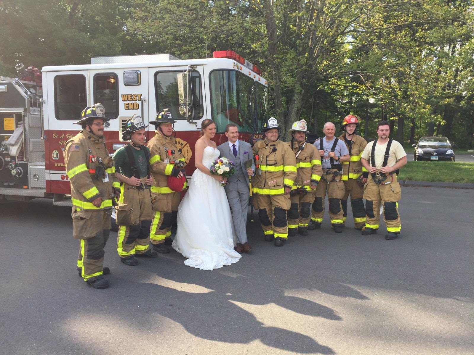 The bride and groom pose with Avon firefighters. (Avon Volunteer Fire Department)
