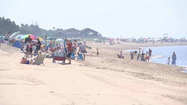 People hit the beach Sunday morning to beat the heat (WFSB)