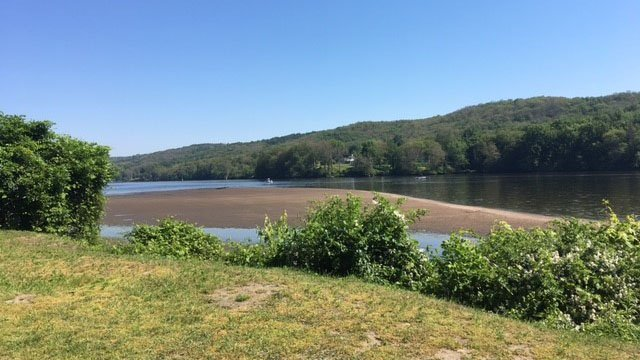Search crews on Monday continue their efforts to locate a 17-year-old boy who was swept under water in Haddam on Sunday. (WFSB)