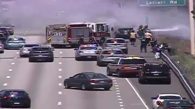 A car fire spreads to brush along I-91 in Hartford on Monday morning. (CT DOT)