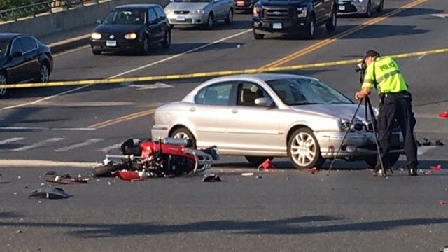 A crash involving a motorcycle and a car impacted traffic on Main Street in Willimantic on Tuesday morning. (WFSB)