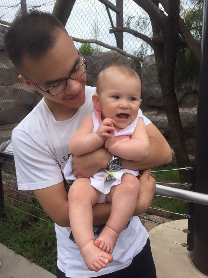 Sonar Technician 3rd Class Ngoc T Truong Huynh, 25, from Oakville, Connecticut was one of seven sailors in the collision of the USS Fitzgerald, seen here, holding his niece. (Courtesy of Lan Thi Huynh)