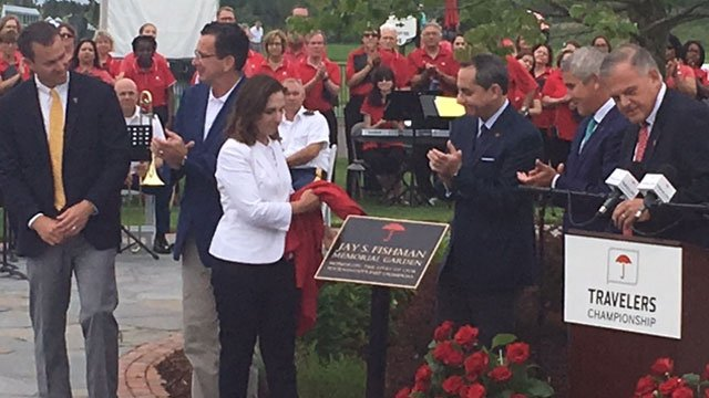 At the end of the ceremony, they unveiled a plaque for the Jay S. Fishman Memorial Garden. (WFSB)