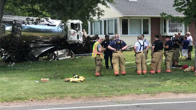 A tanker truck hit a home in Suffield Sunday. (WFSB)