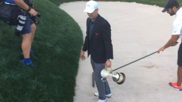 Jordan Spieth with the trophy from the spot he hit the winning sand shot 2017 Travelers Championship. (WFSB)