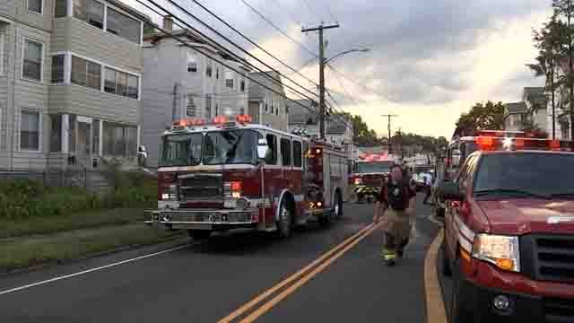Crews battled a house fire in New Britain on Tuesday (WFSB)